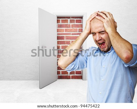 stressed man and closed door - stock photo