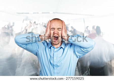 stressed man and lots of people background - stock photo