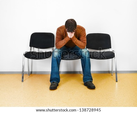 stressed man in a waiting room - stock photo