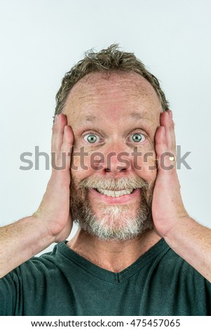 Stressed man in beard with crazy expression.