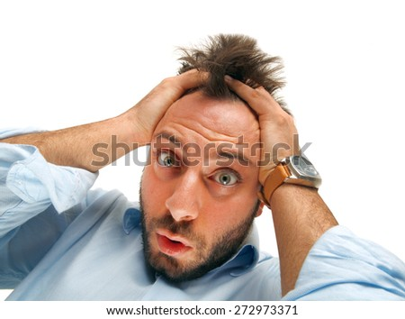 Stressed man tear his hair out, crazy face expression, isolated on white. - stock photo