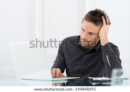 Stressed Man Working On Laptop - stock photo