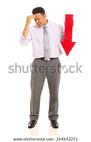 stressed mature businessman holding arrow pointing down on white background - stock photo