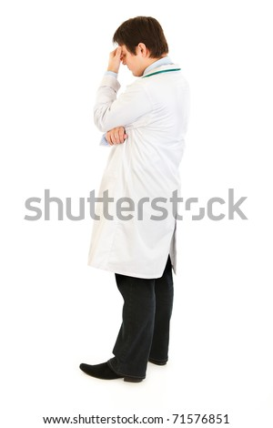Stressed medical doctor holding fingers at noseband isolated on white - stock photo