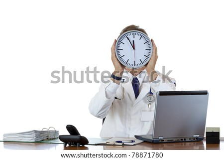 Stressed medical holds clock in front of face because of time pressure.Isolated on white background. - stock photo