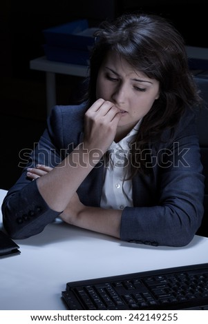 Stressed out and frustrated businesswoman biting her nails - stock photo