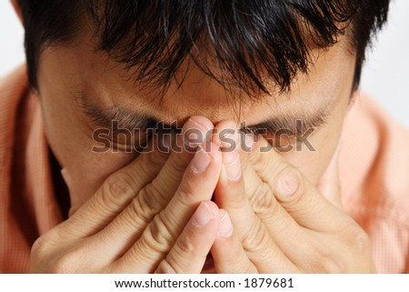 Stressed out businessman having a headache - stock photo