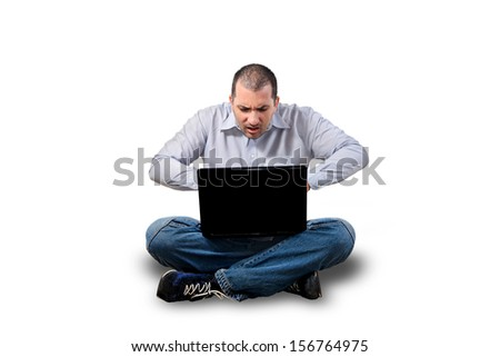 stressed out businessman in front of laptop