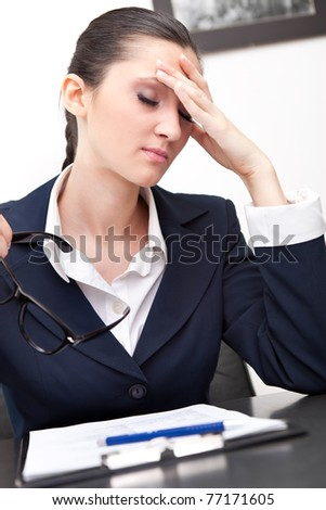 stressed out businesswoman has headache in office - stock photo