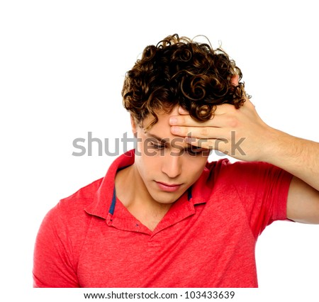 Stressed out guy with hand on his forehead. Sadness and despair - stock photo