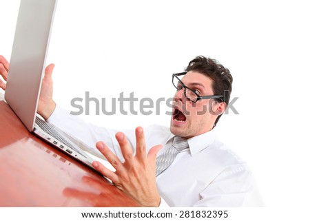 stressed out man with computer on white background - stock photo