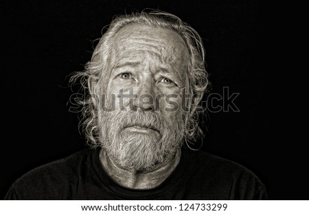 Stressed out older man isolated against black sepia toned - stock photo