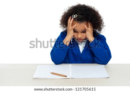 Stressed out primary girl child thinking hard to recollect the answer - stock photo