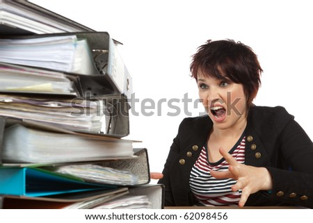 Stressed Out Worker At Her Desk With Files On White Isolated Background
