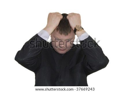 Stressed out young business man over white background - stock photo