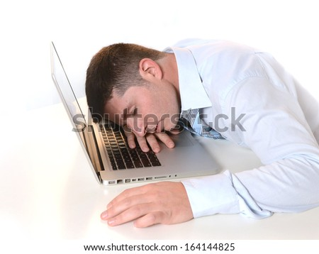 Stressed  Overworked Businessman sleeping over keyboard at Work  - stock photo
