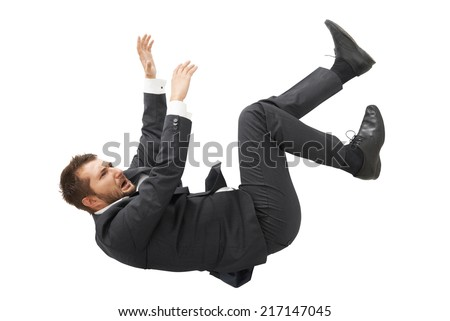 stressed screaming businessman in black suit falling down over white background - stock photo
