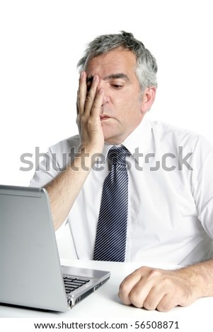 stressed senior businessman gesture working laptop computer white desk - stock photo