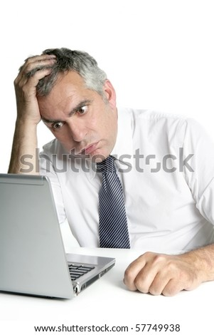 stressed senior businessman gesture working laptop computer white desk - stock photo