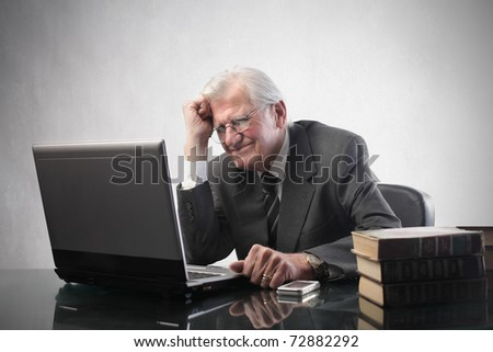 Stressed senior businessman in front of a laptop - stock photo