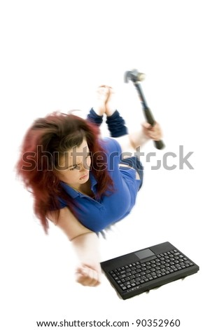 stressed teenage girl hitting keyboard with hammer