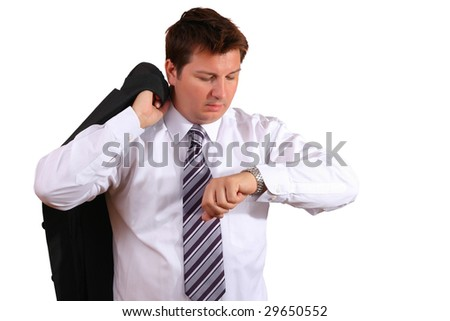 Stressed up office worker or a businessman late for an appointment work looking at his watch - stock photo