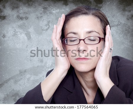 Stressed woman holding her head with headache - stock photo