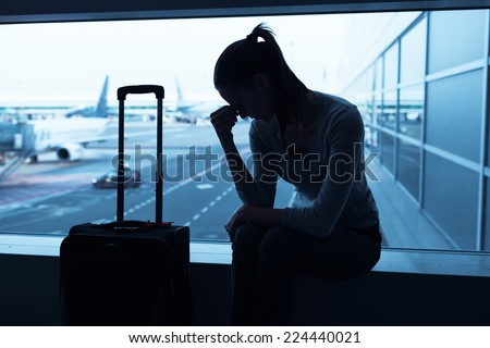 Stressed woman in the airport - stock photo