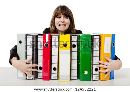 Stressed woman in the office holding  folders - stock photo