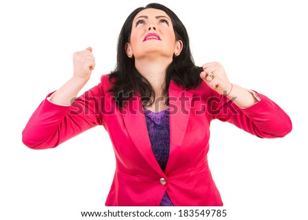 Stressed woman looking up and showing fists isolated on white background - stock photo