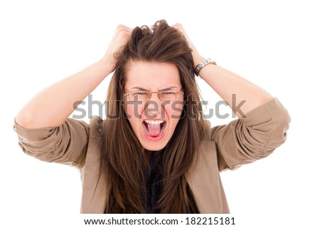 stressed woman pulling her hair in frustration and screaming - stock photo
