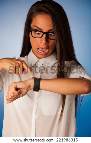 stressed woman staring into watch gesturing being late - stock photo