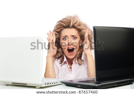 Stressed woman / Too much work for one office worker, businesswoman with two laptops - stock photo