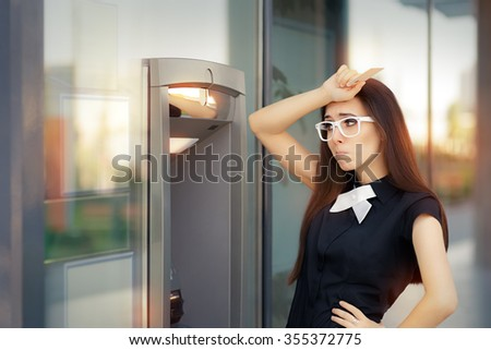 Stressed Woman with credit card at ATM - Funny broke businesswoman checking account balance   - stock photo