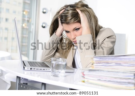 stressed woman working on computer - stock photo
