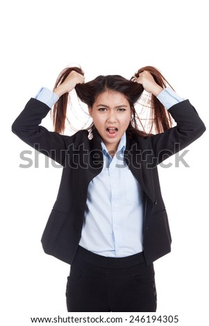 Stressed young Asian businesswoman is going crazy pulling her hair  isolated on white background - stock photo