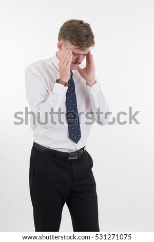 stressed young business man with hands on head with bad headache on white  background