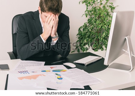 Stressed Young Businessman at Office - stock photo