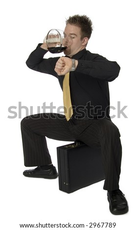 Stressed young businessman drinking coffee from pot and checking time - stock photo