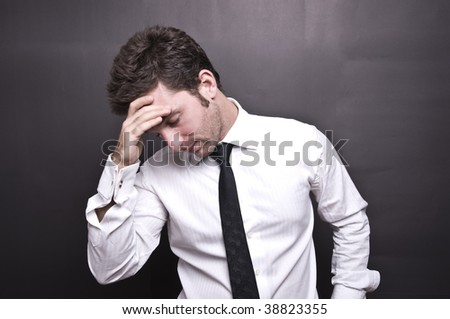 stressed young businessman III - stock photo