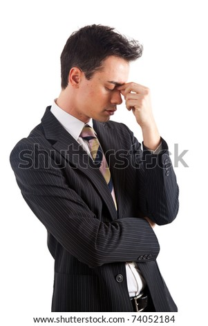 Stressed young businessman isolated on white - stock photo