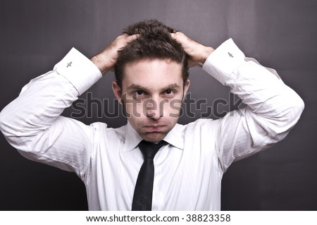 stressed young businessman IV - stock photo