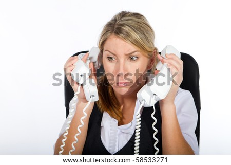 stressed young businesswoman dealing with a lot of phone calls at same time - stock photo