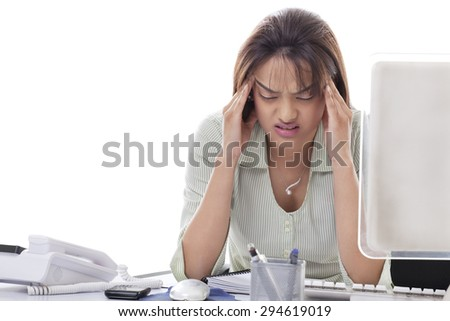 Stressed young businesswoman with head in hands at office - stock photo