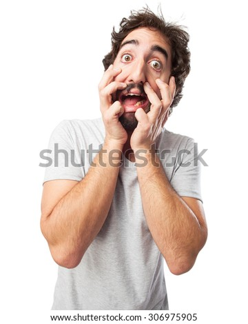stressed young man scared pose - stock photo