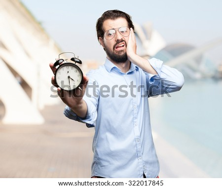 stressed young man with clock