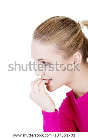 Stressed young woman eating her nails , isolated on white. - stock photo