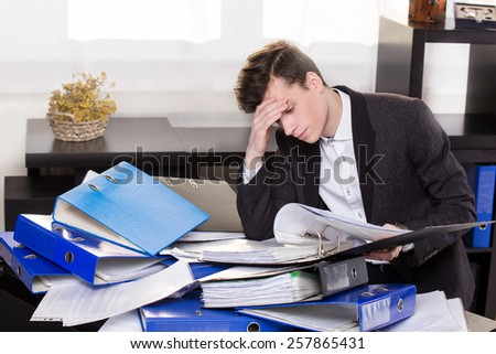 Stressful business man have so many paperwork in the office - stock photo