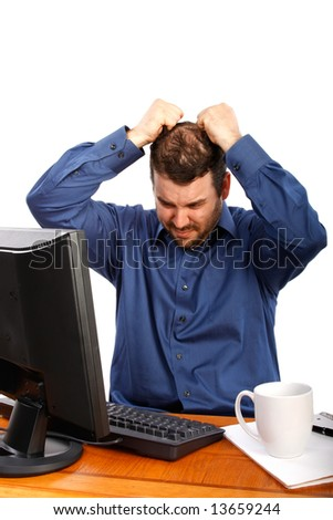 Stressful Business Man Pulling Hairs in front of Computer - stock photo