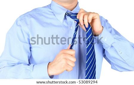 Stressful businessman untying his necktie - stock photo